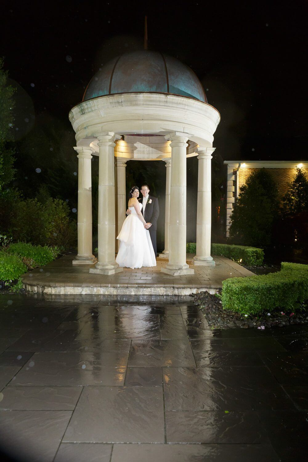 Nightime photo of the bride and groom on a rainy night at the rockleigh Country Club New Jersey Wedding Photography