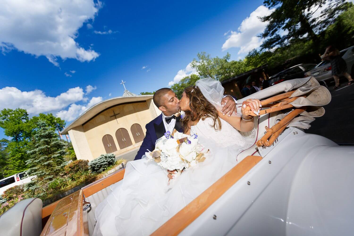 Bride and in groom in the back of their convertable limo New Jersey Wedding Photography