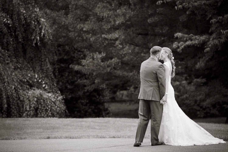 Wedding Couple kissing at the Frelinghuysen Arboretum New Jersey Wedding Photographer
