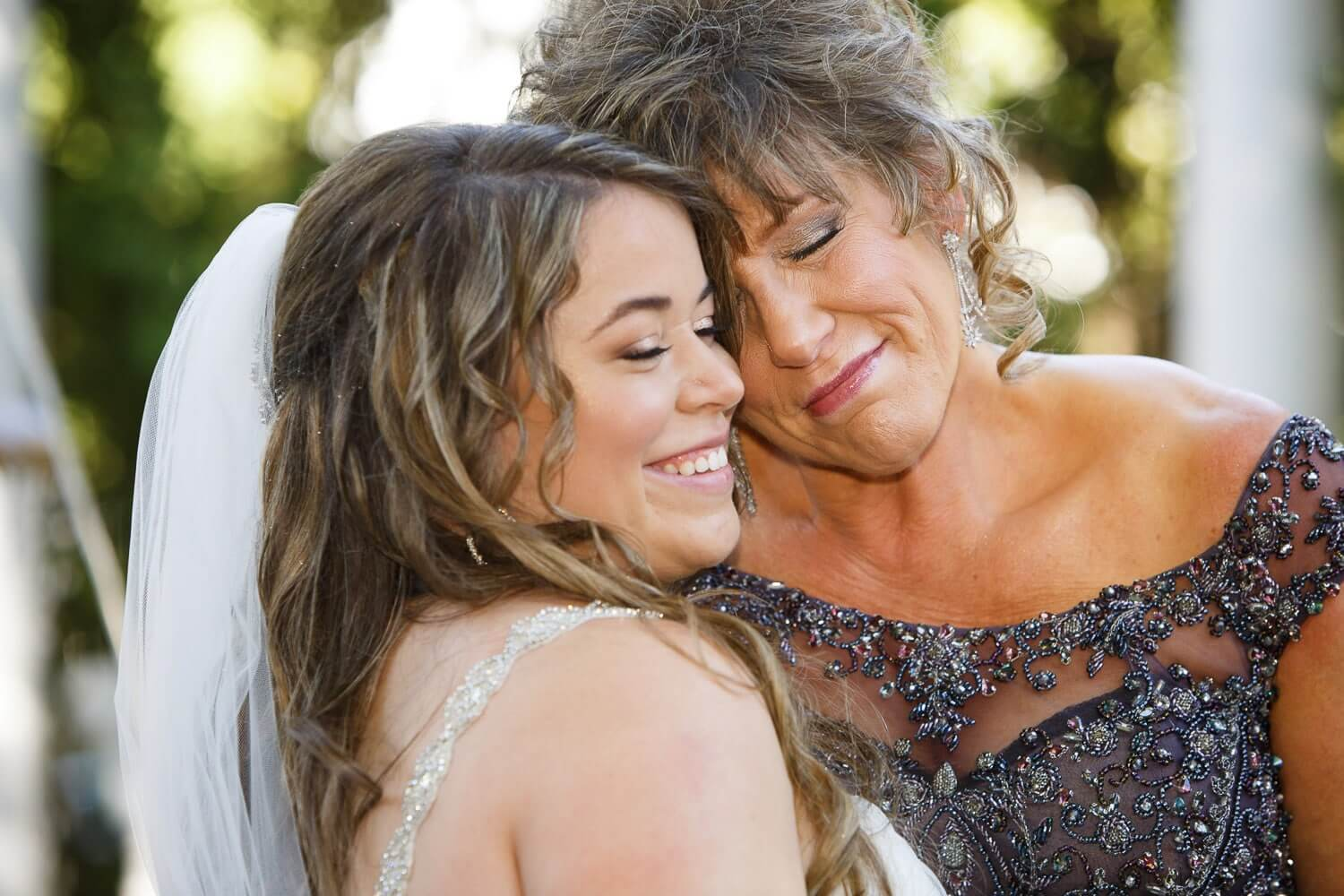 bride and mom warm embrace at the Brownstone New Jersey Wedding Photographer