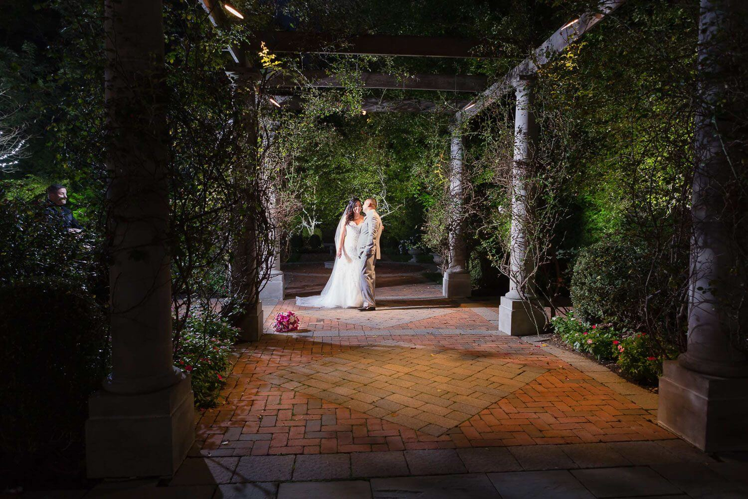 Nightime photo of the bride and groom in the gardens at The Estate at Florentine Gardens New Jersey Wedding Photography