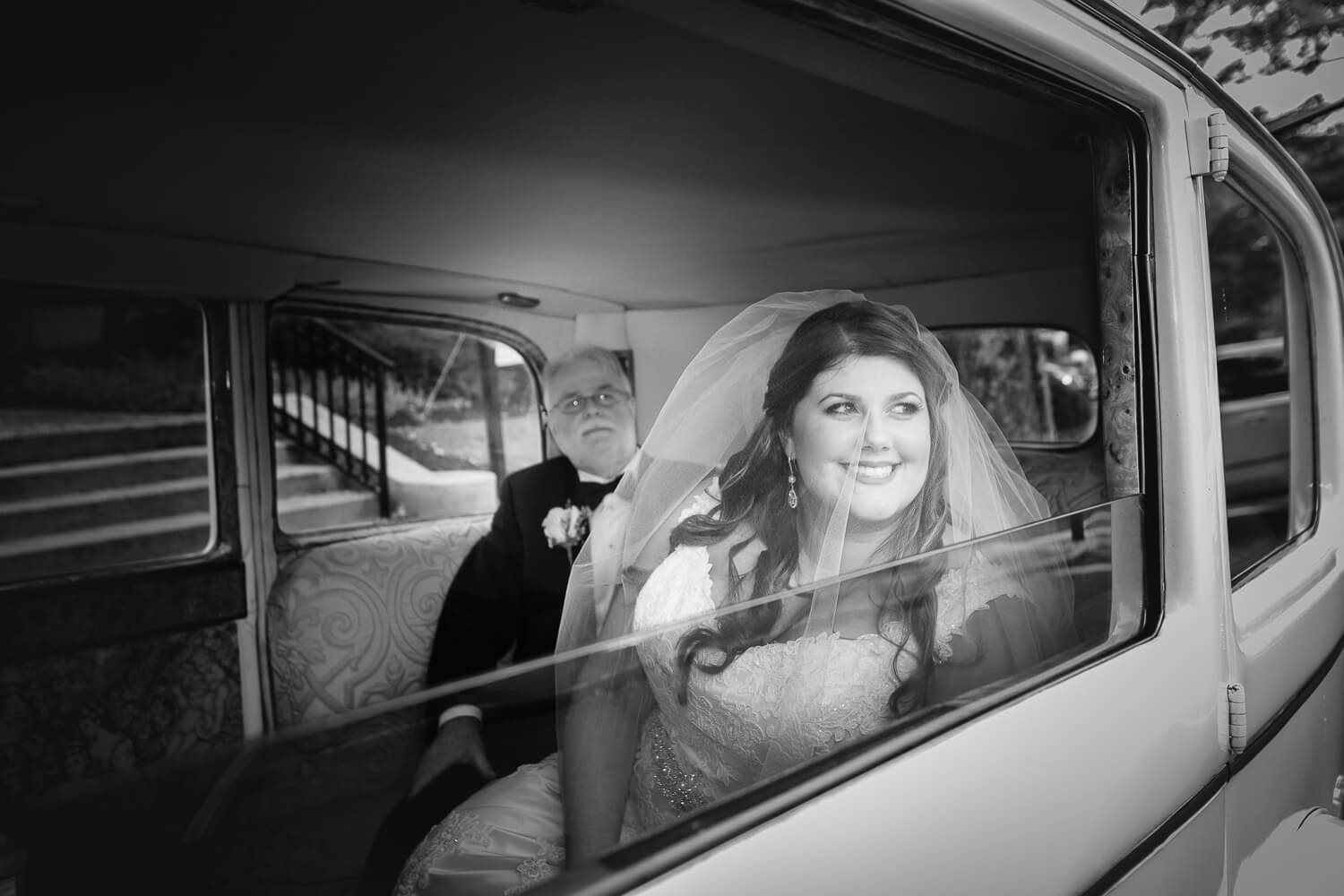 Bride and dad in the limo wait for her ceremony New Jersey Wedding Photographer