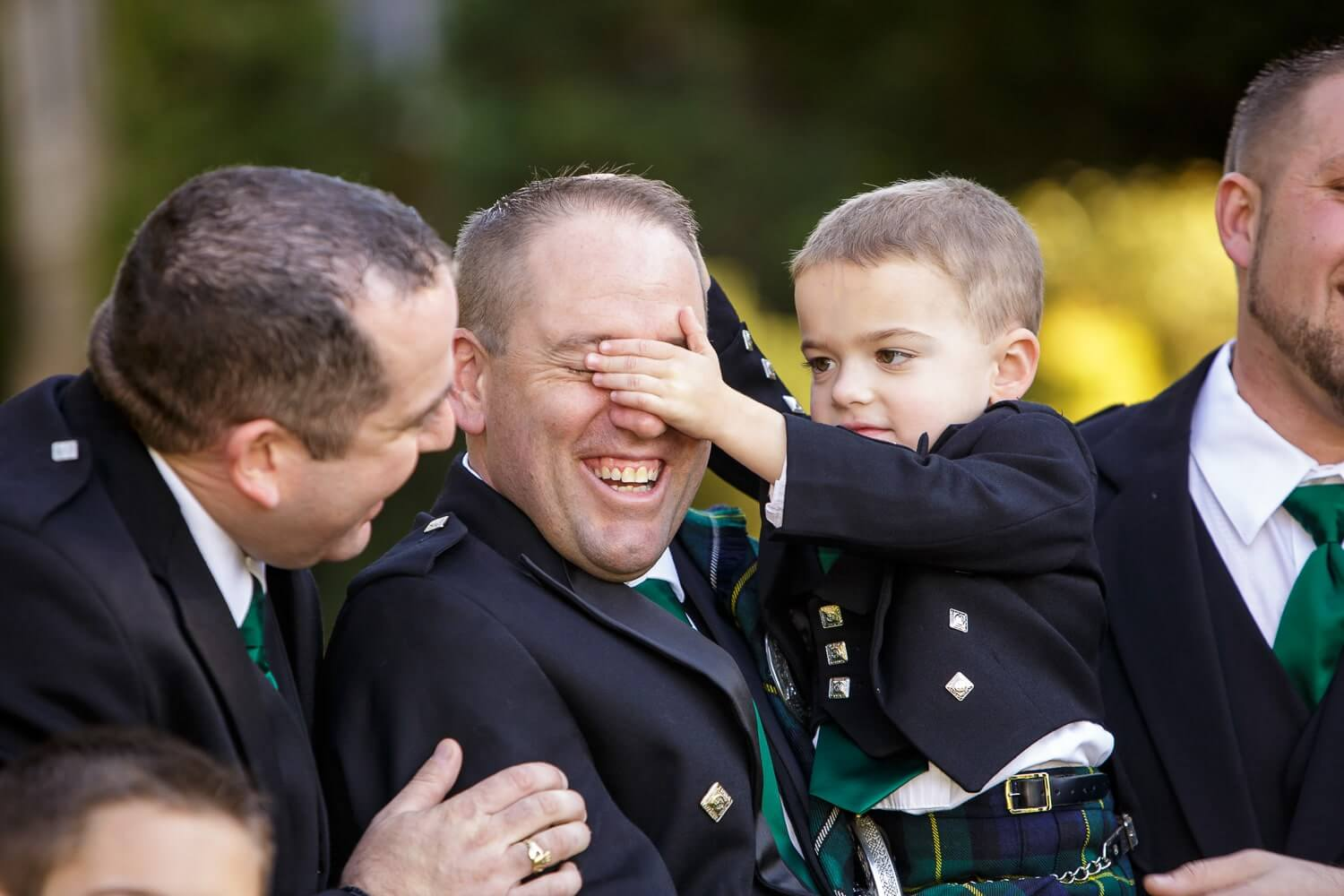 Ring Bearer covering grooms eyes at first look at the castle at skyland Manor New Jersey Wedding Photographer
