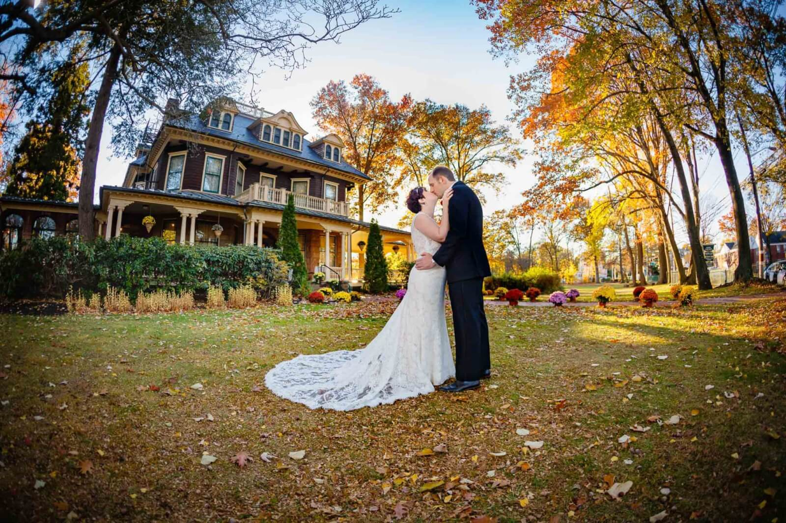 Bride and Groom dipping in front of the Oakside Mansion