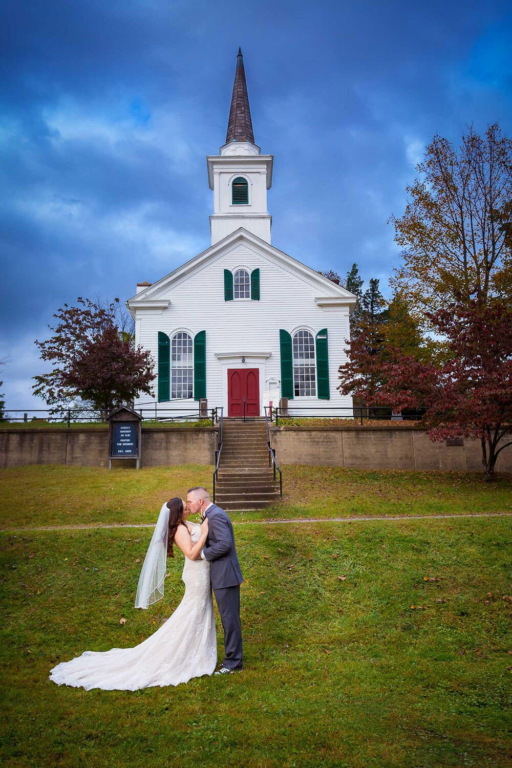 Bride and groom in front of old Church at Waterloo Village Wedding Photo New Jersey Wedding Photographer