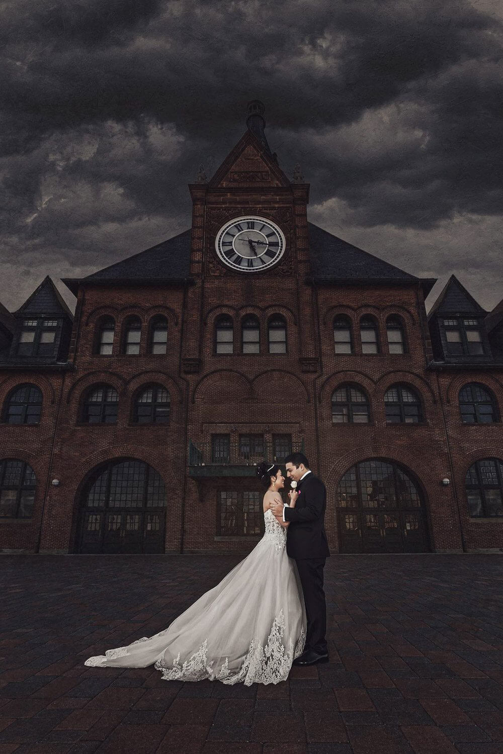New Jersey wedding Photo of bride and groom in front of the of a historic building at Liberty State Park New Jersey Wedding Photographer