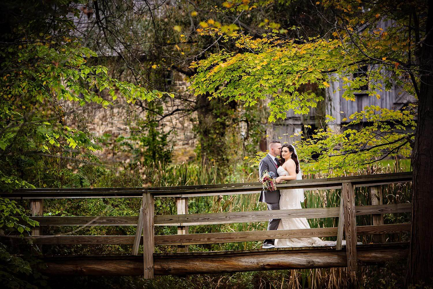 A Wedding couple on and old wood bridge at waterloo village New Jersey Wedding Photographer