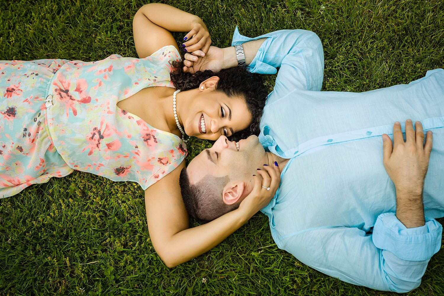 New Jersey engagement photo of a couple laying on the ground look at each other