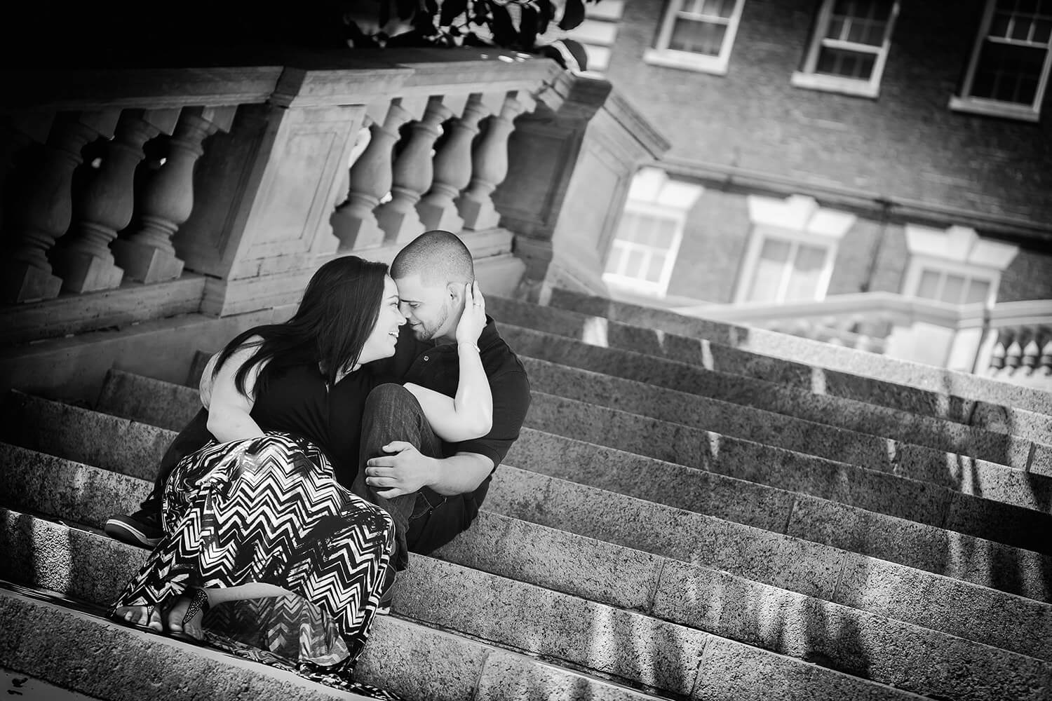 New Jersey engagement photo of a couple on the stairs of Fairleigh Dickenson University in Madison nj