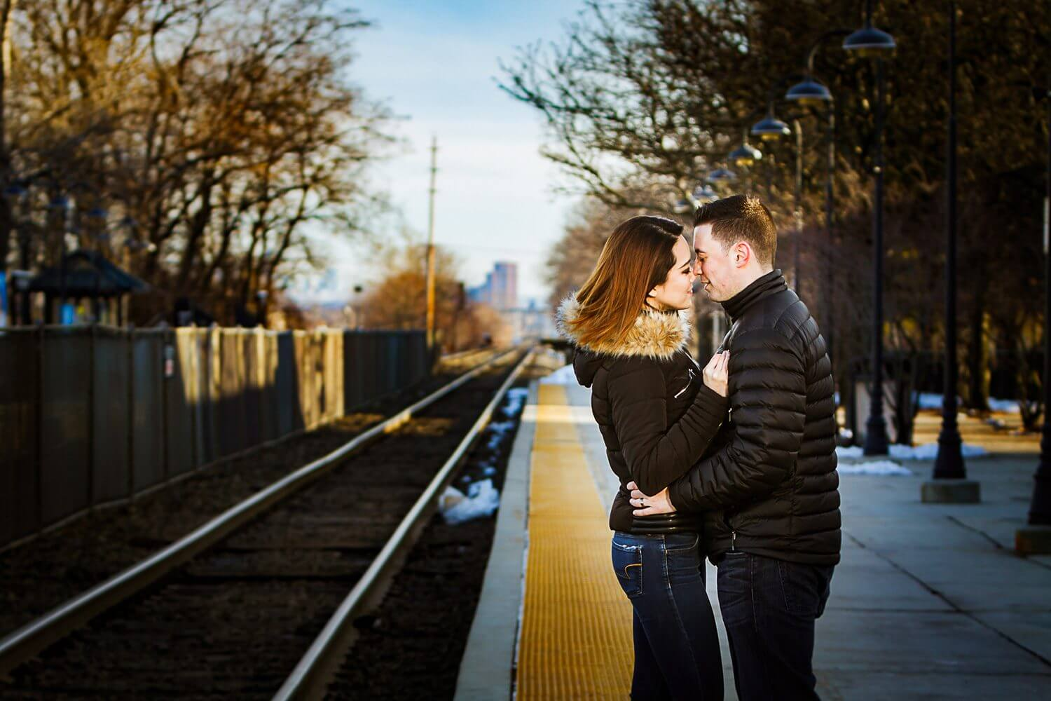 New Jersey engagement photo of a couple at the train staion in rutherford nj