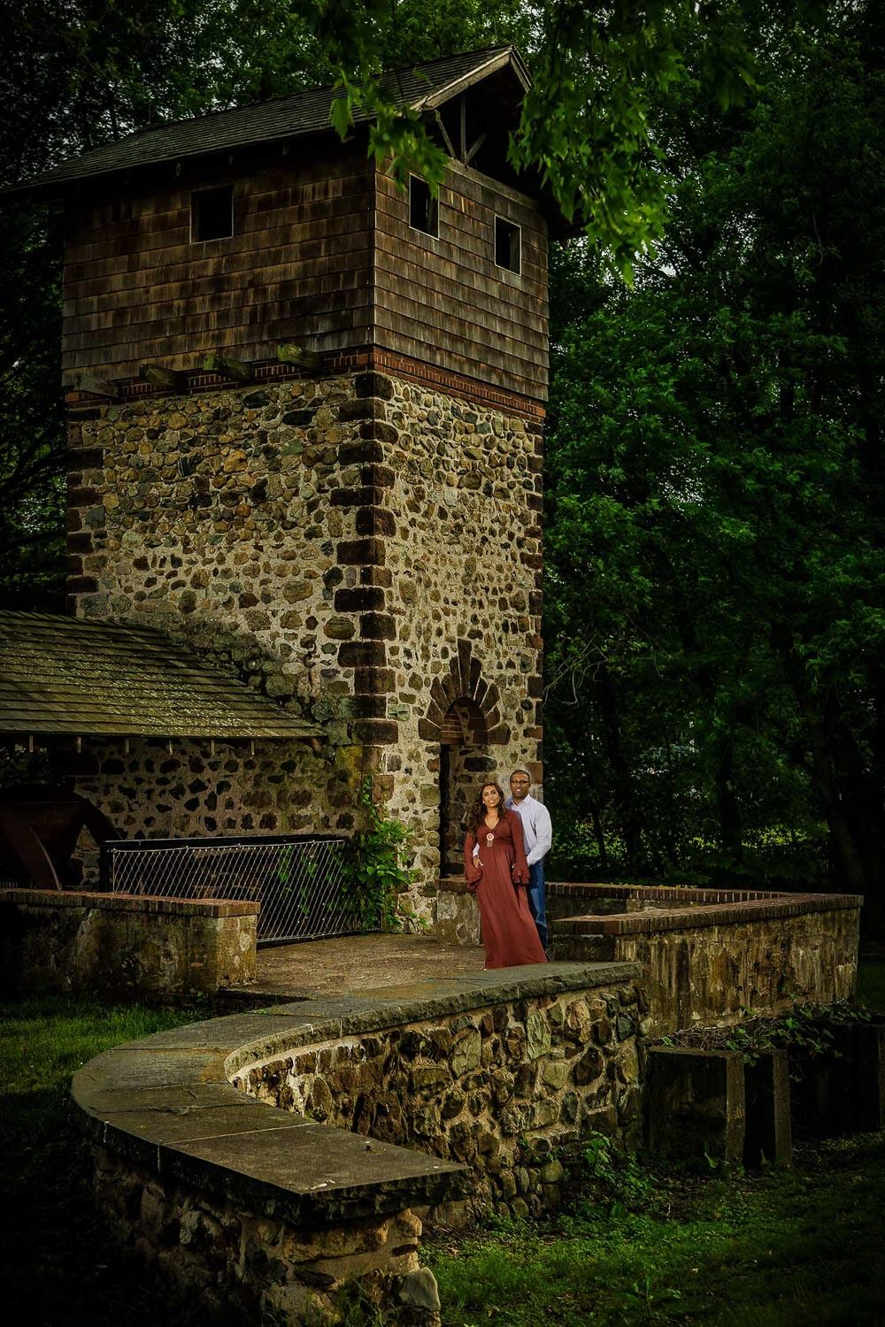 New Jersey engagement photo of a couple in front of Easton Tower