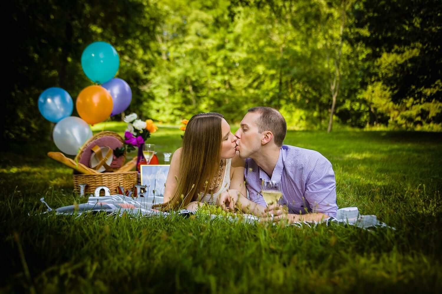 New Jersey engagement photo of a couple laying side by side in a picinic setting at Ramapo reservation