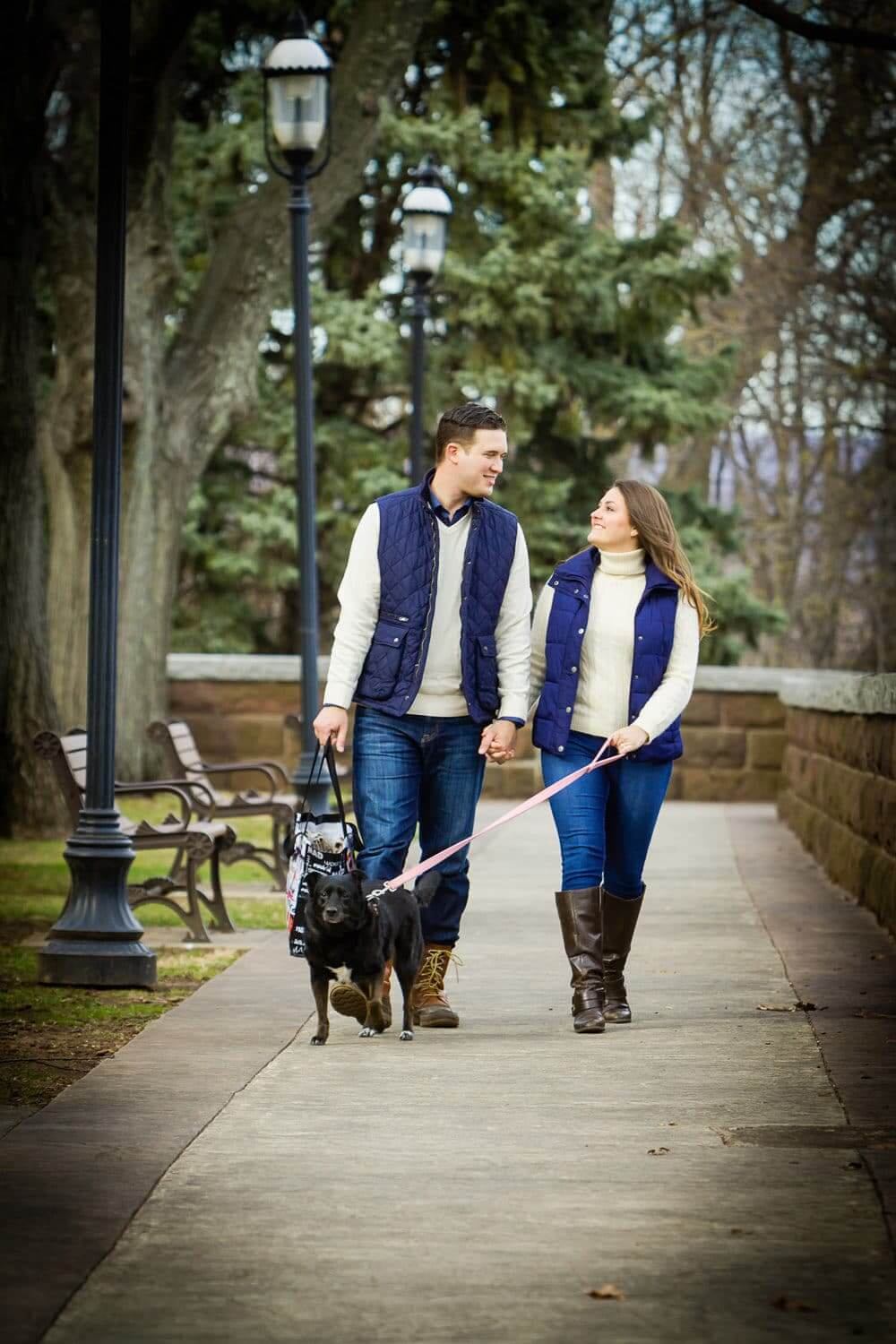 New Jersey engagement photo of a couple walking with their dog