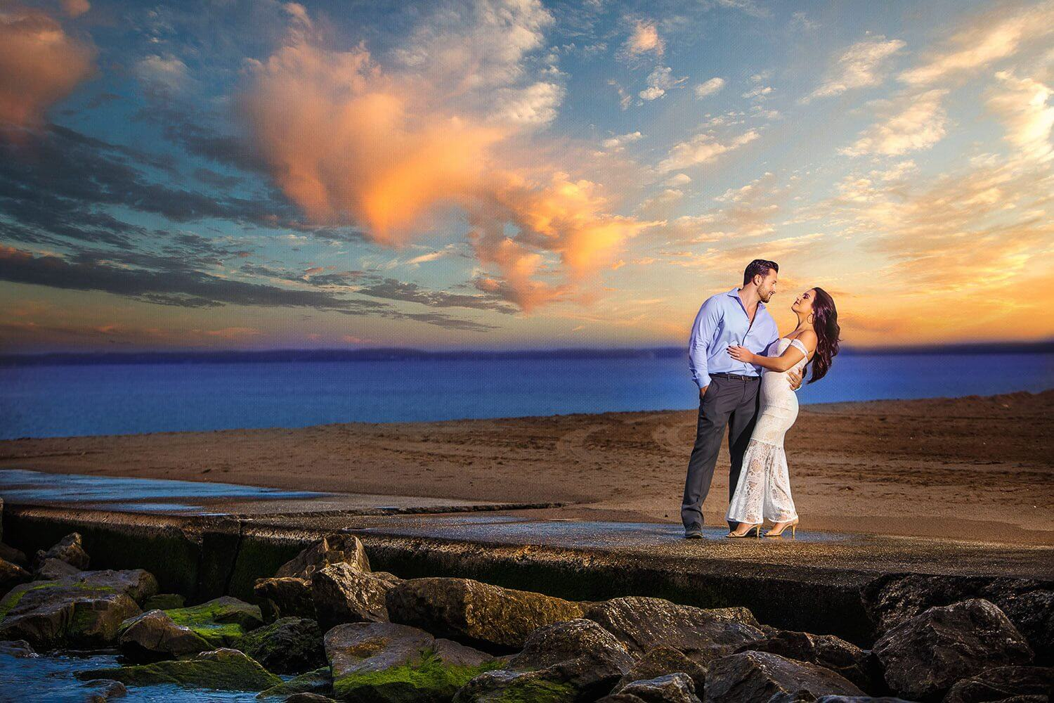 New Jersey engagement photo of a couple on a beach for a dramatic photo