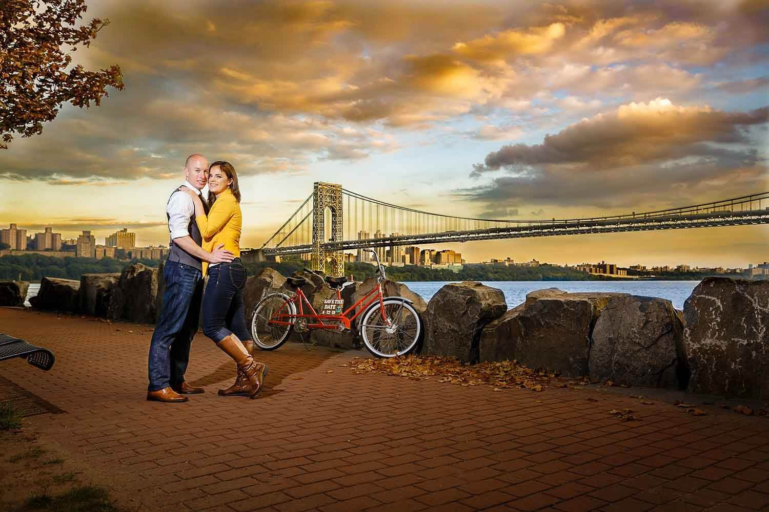 New Jersey engagement photo of a couple at Ross Dock for a sunset picture a the George washington bridge
