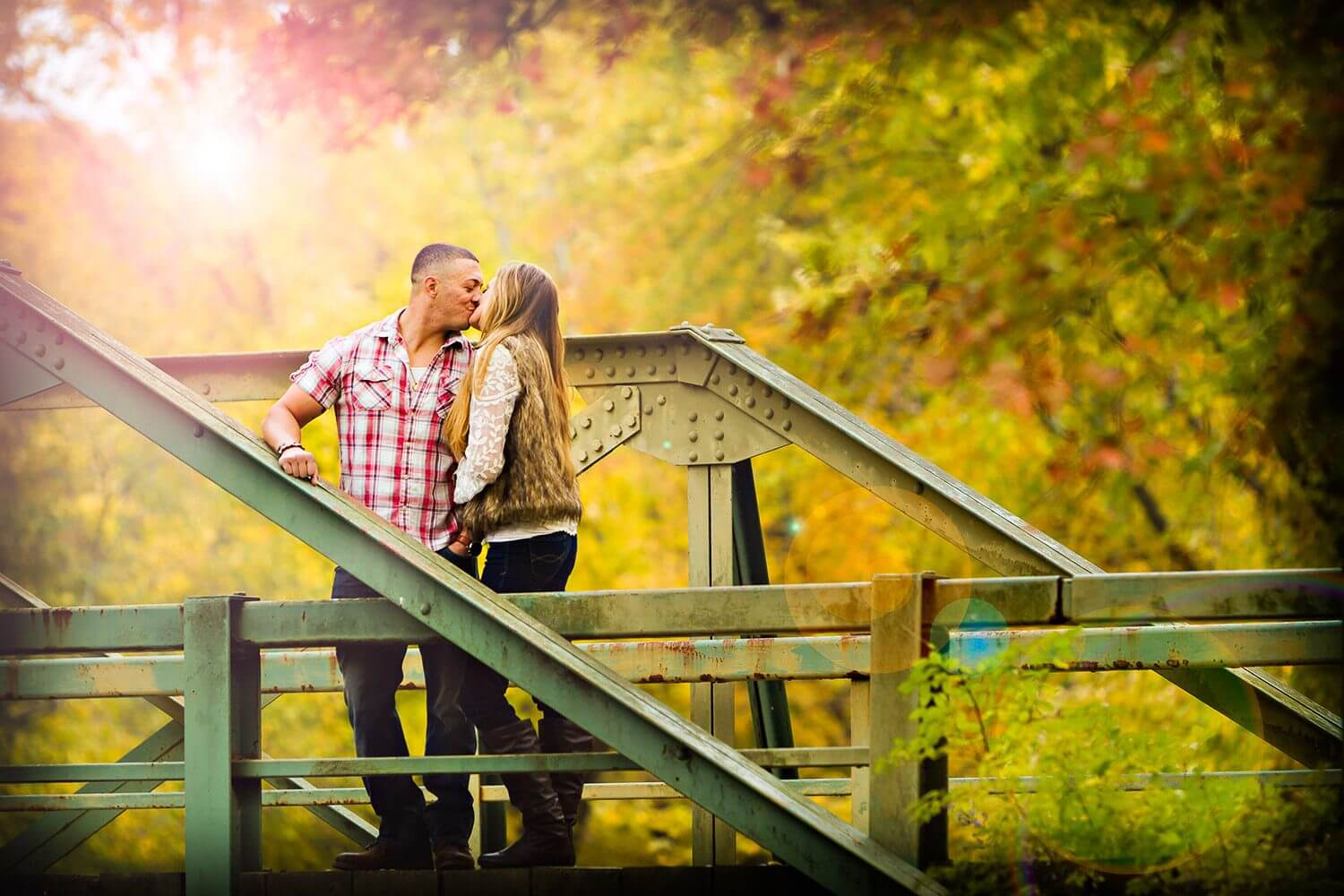 New Jersey engagement photo of a couple on the bridge at ramapo reservation