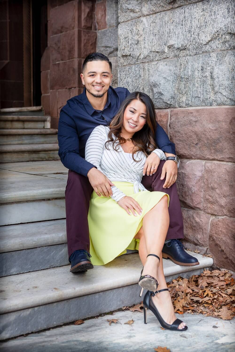 New Jersey engagement photo of a couple sitting on the stairs at Lambert castle