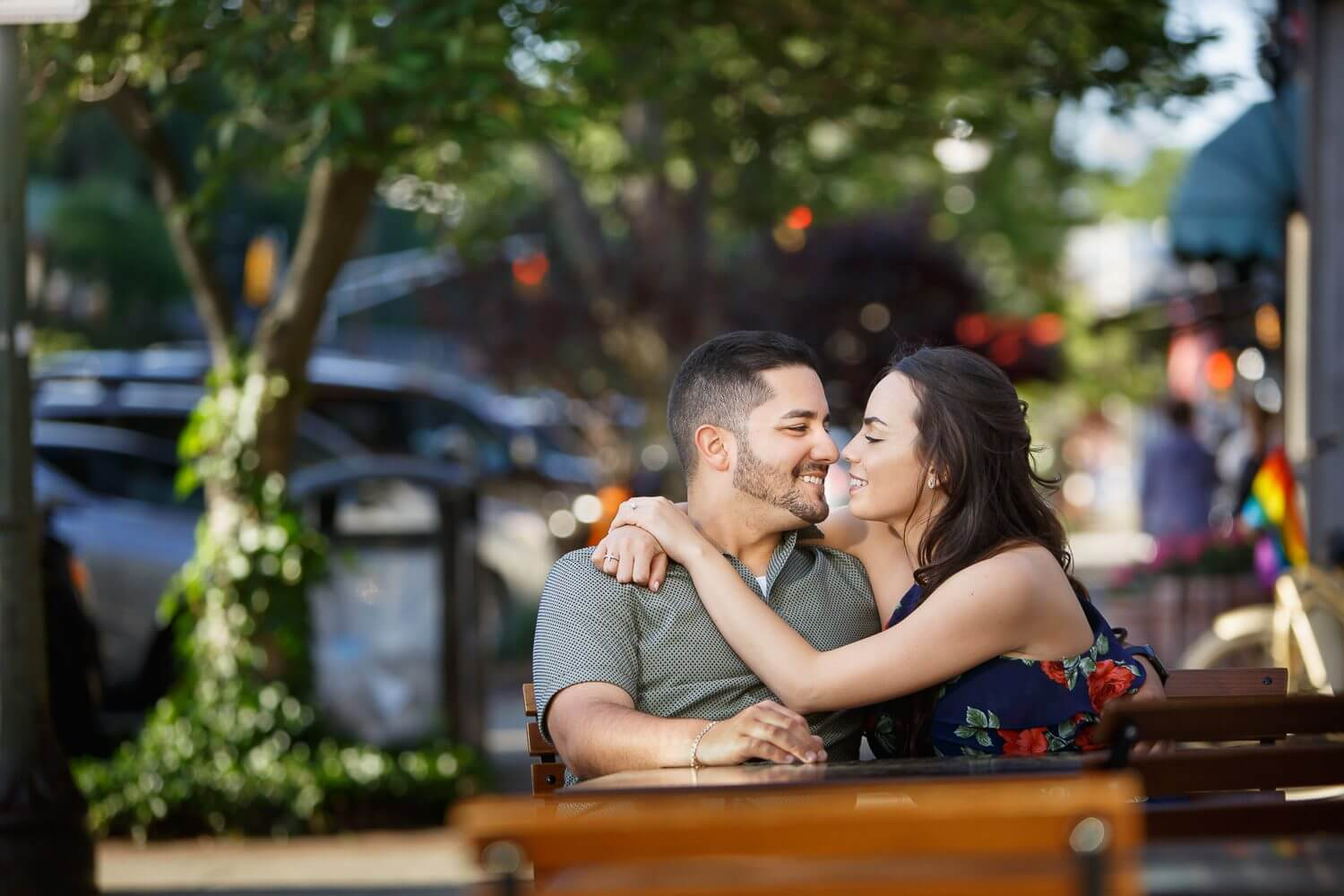 New Jersey engagement photo of a couple at a cafe in ridgewood