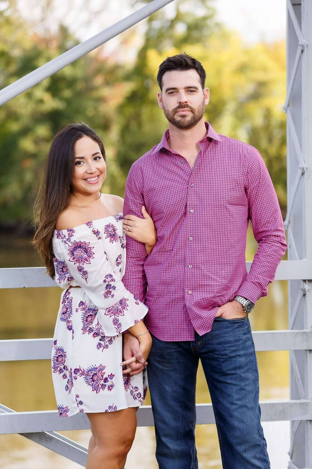 New Jersey engagement photo of a couple on a metal bridge