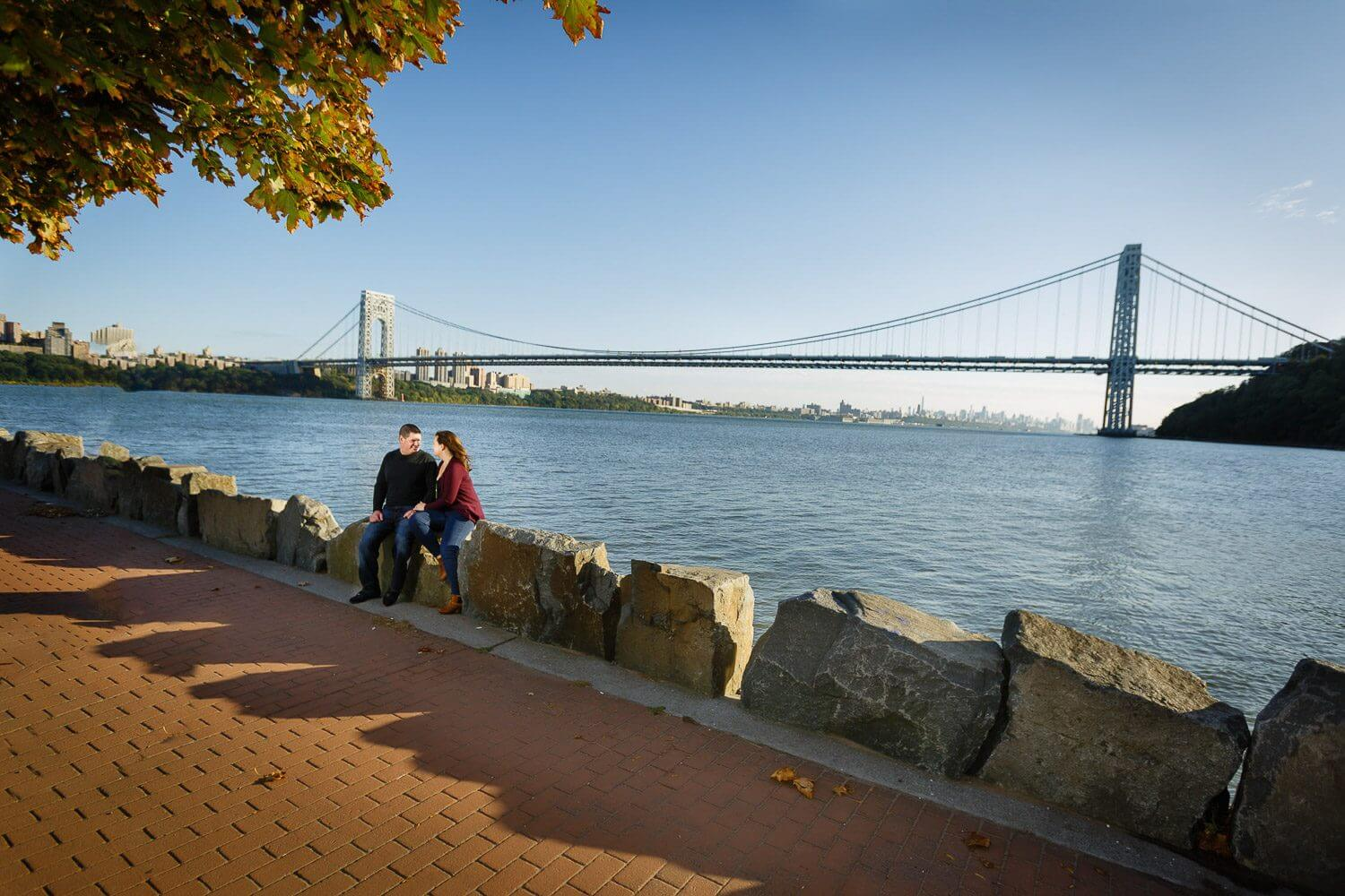 New Jersey engagement photo of a couple talk by the George washington Bridge  from Ross Dock