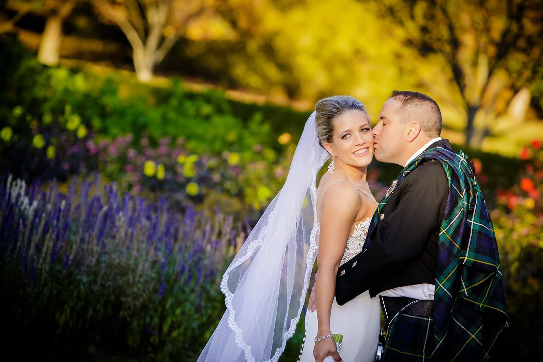 Groom kissing bride at the Skylands Manor