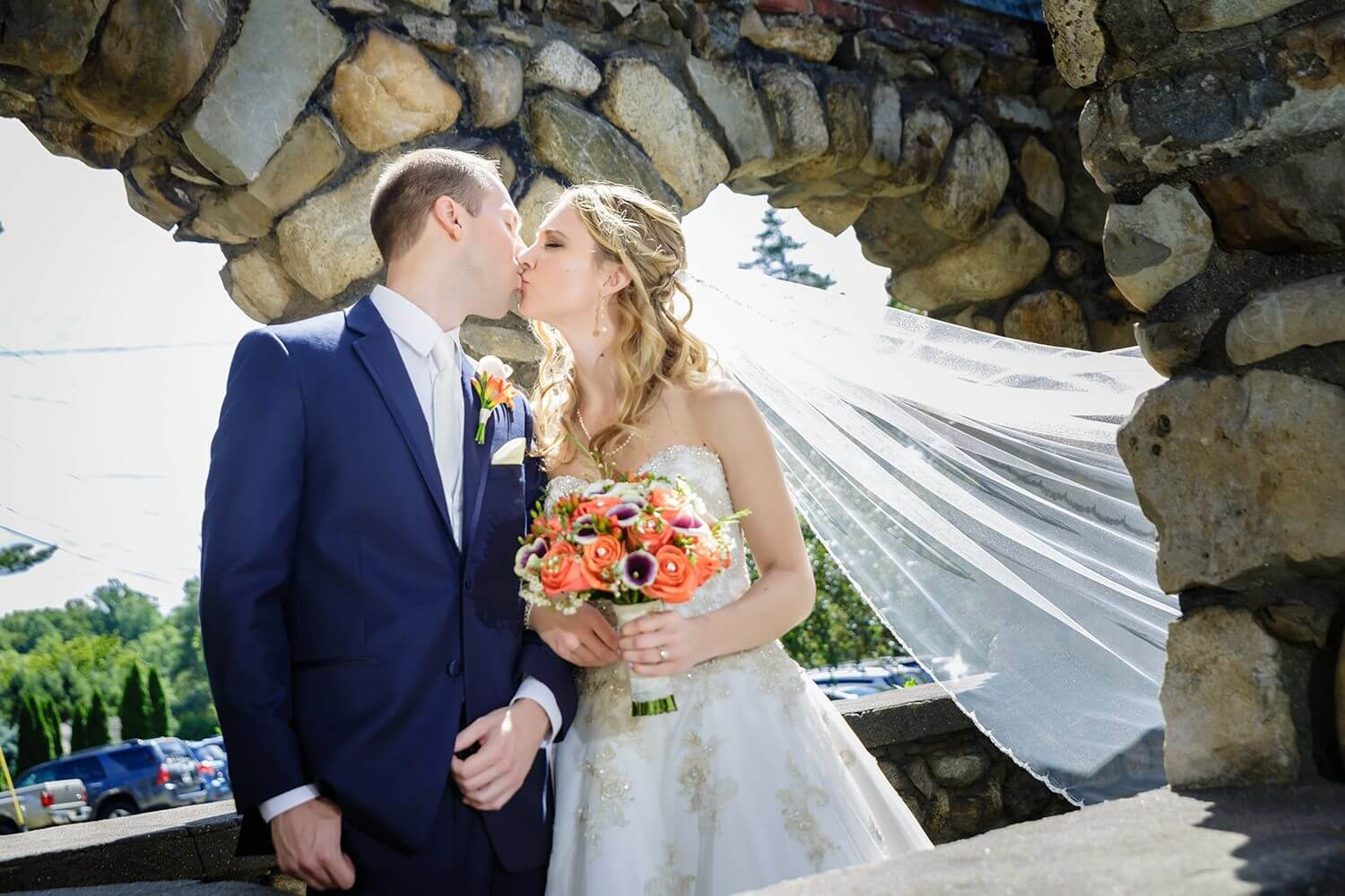 Wedding Photo of a couple kissing at the Ramsey Country Club