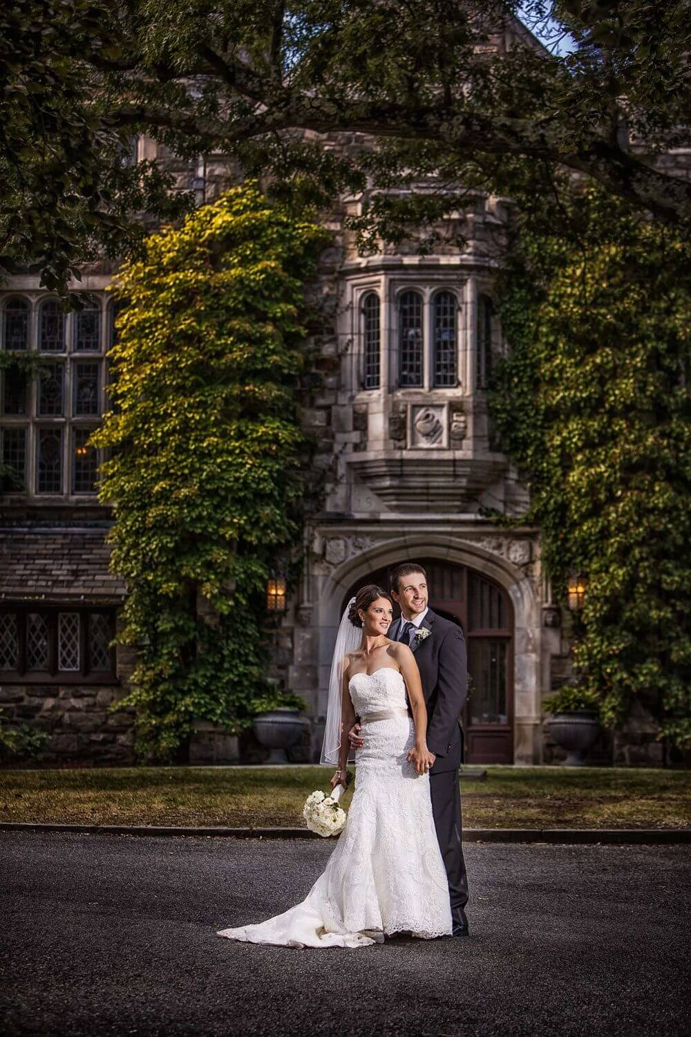 Bride and Groom in the front of the castle at Skyland Manor wedding Photo New Jersey Wedding Photographer