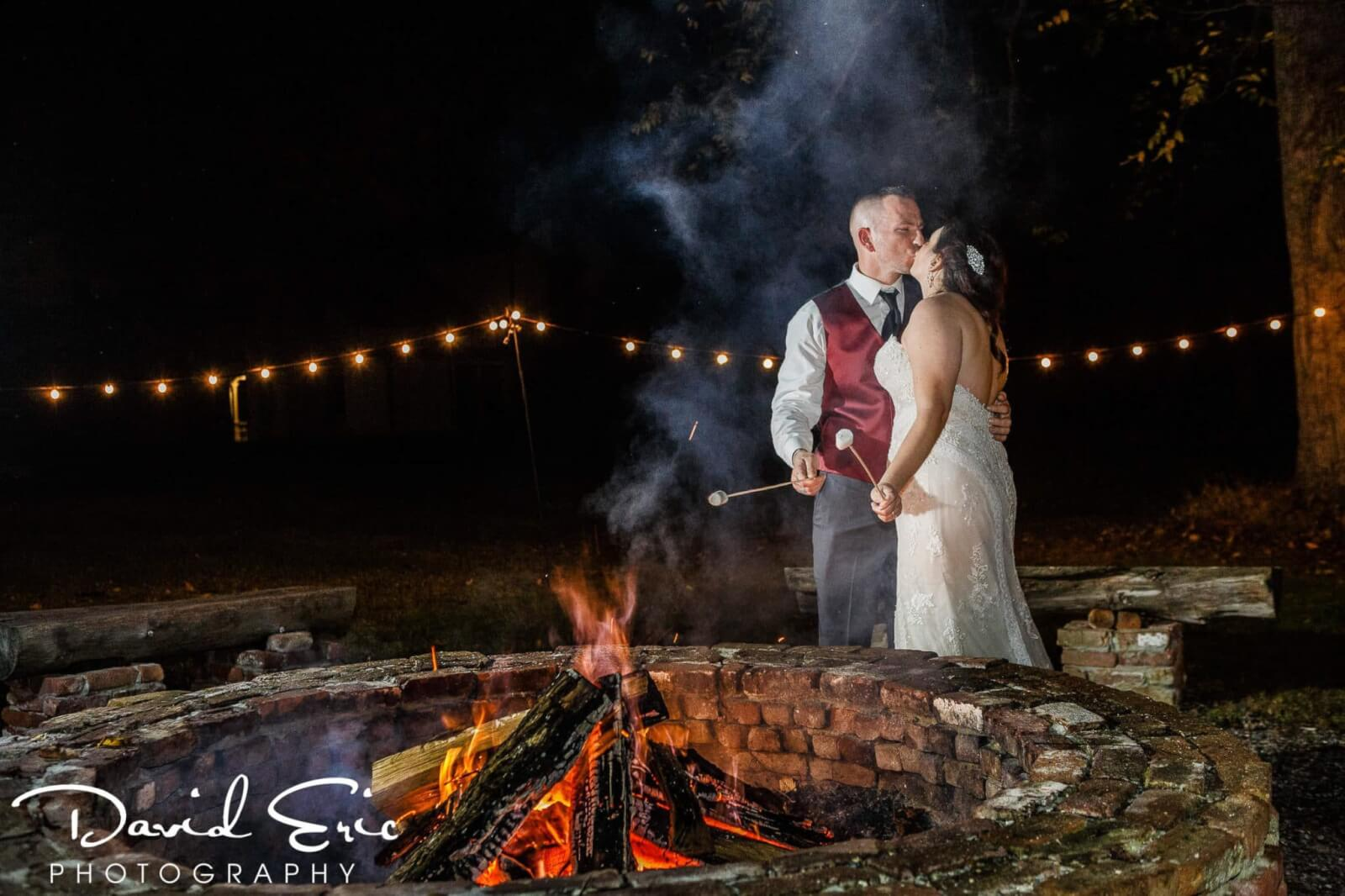 Wedding Venues New Jersey Waterloo Village bride and groom roasting marshmallows over the fire pit